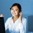 Young woman in business wear and headset — Stock Photo #9220874