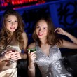 Young woman in night club with a drink — Stock Photo #9221148