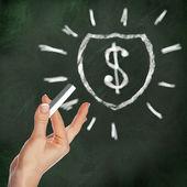 School blackboard and dollar symbol — Stock Photo