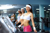 Woman in sport wear doing sport in gym — Stock Photo