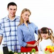 Family with a daughter cooking together at home — Stock Photo #9295700