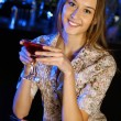 Royalty-Free Stock Photo: Attractive woman in night club with a drink