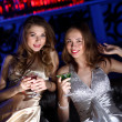 Young woman in night club with a drink — Stock Photo #9296252