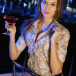 Stock Photo: Attractive woman in night club with a drink
