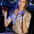 Attractive woman in night club with a drink — Stock Photo #9296643
