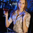 Attractive woman in night club with a drink — Stock Photo #9296847