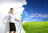 Young businesswoman and nature background — Stock Photo
