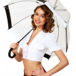Woman dressed in retro style with umbrella - Stock Photo