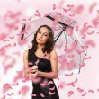 Pretty woman under umbrella with petals around her — Stock Photo #9317178