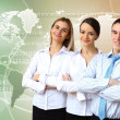 Three successful young business persons together — Stock Photo #9317330