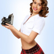 Woman dressed in retro style with camera — Stock Photo #9317988