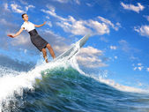 Businesswoman surfing on the sea waves — Stock Photo