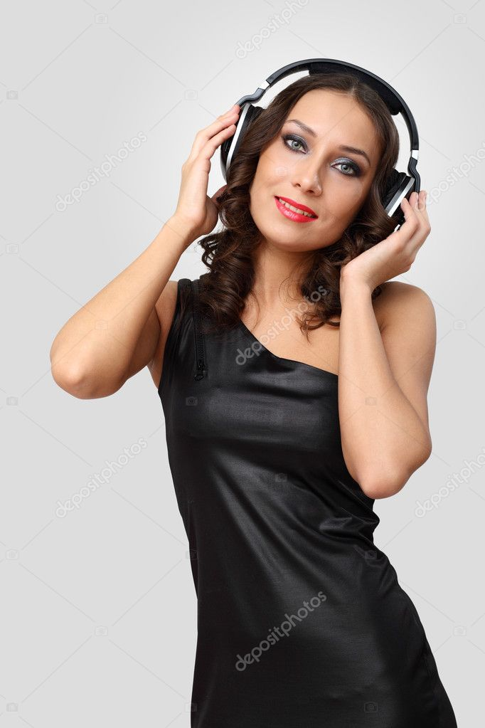 Portrait of young woman in evening dress with headphones — Stock Photo #9317598