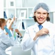 Young scientists working in laboratory — Stock Photo #9368174