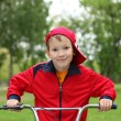 Boy on a bicycle in the green park — Stock Photo #9368186