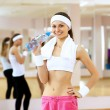 Woman in sport wear doing sport in gym - Stock Photo