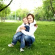 Mother with her son outside — Stock Photo #9368304