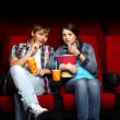 Young couple in cinema watching movie — Stock Photo #9368370