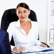 Young woman in business wear in office — Stock Photo
