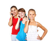Pretty teenage girls with mobile phone — Stock fotografie