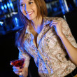 Attractive woman in night club with a drink — Stock Photo #9398662