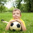 Little boy in the park with a ball - Foto Stock