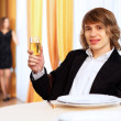 Young handsome man sitting in restaurant - Stok fotoğraf