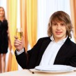 Young handsome man sitting in restaurant — Stock Photo #9398968