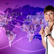 Young woman against world map background — Stock Photo #9399425