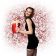 Woman in black dress with a gift box - Stock Photo