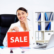Young woman in business wear with sale sign — Stock Photo