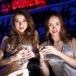 Young woman in night club with a drink - Stok fotoğraf