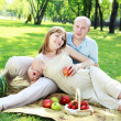 Young couple on picnic in the park — Stock Photo