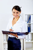 Young woman in business wear in office — Foto Stock