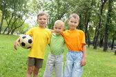 Three boys in the park — Stock Photo
