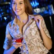 Attractive woman in night club with a drink — Stock Photo #9573593