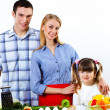 Family with a daughter cooking together at home — Stock Photo #9574561