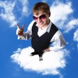 Young businessman against cloudy sky background - Stock Photo