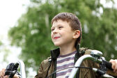 Boy on a bicycle in the green park — Стоковое фото