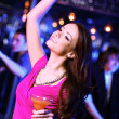 Stock Photo: Young woman having fun at nightclub disco