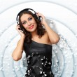 Young woman in evening dress with headphones — Stock Photo #9607924