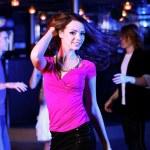 Young woman having fun at nightclub disco — Stock Photo #9609184