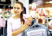 Shopping in clothes store — Stock Photo