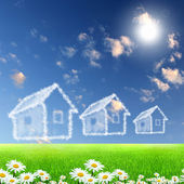 House from white clouds against blue sky — Stock Photo