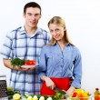 Husband and wife together coooking at home - Foto Stock