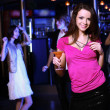 Young woman having fun at nightclub disco — Stock Photo #9634472