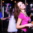 Young woman having fun at nightclub disco — Стоковая фотография