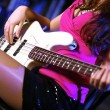 Young guitar player performing in night club — Stock Photo #9901202