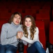 Young couple in cinema watching movie — Stock Photo #9901232