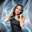 Young woman in evening dress with headphones — Stock Photo #9901331